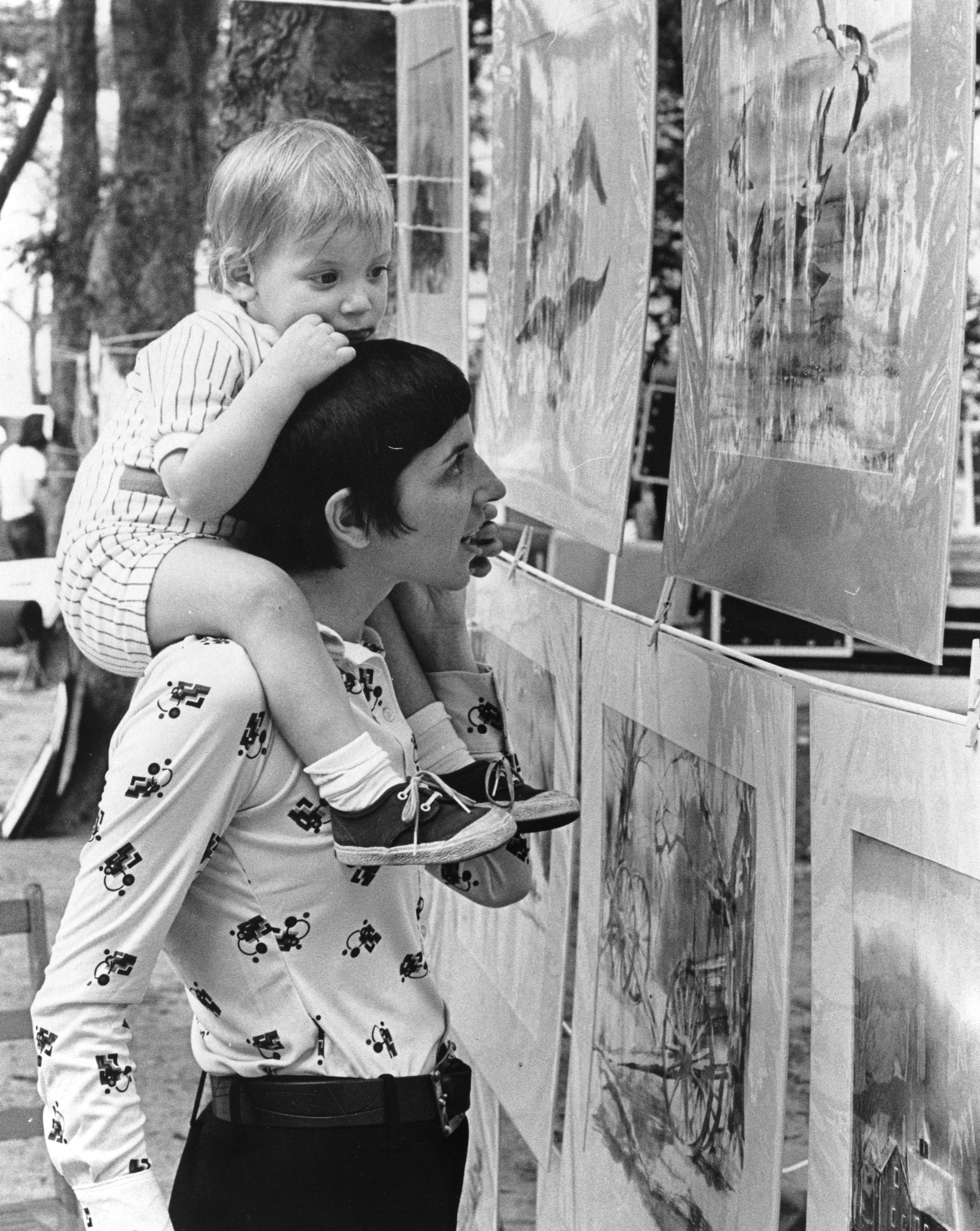Mother and child viewing art