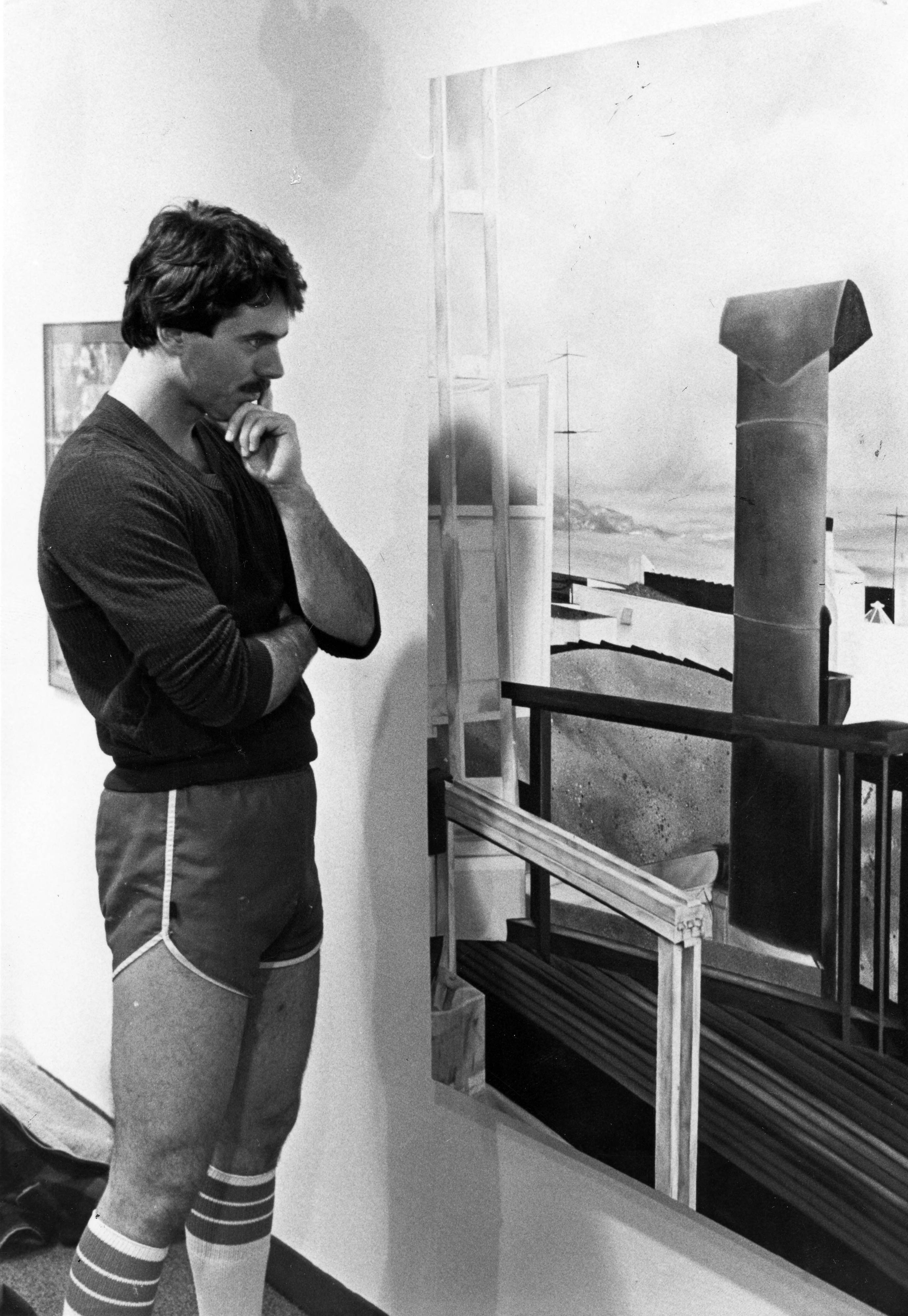 Unidentified male student viewing the student art show, 1980