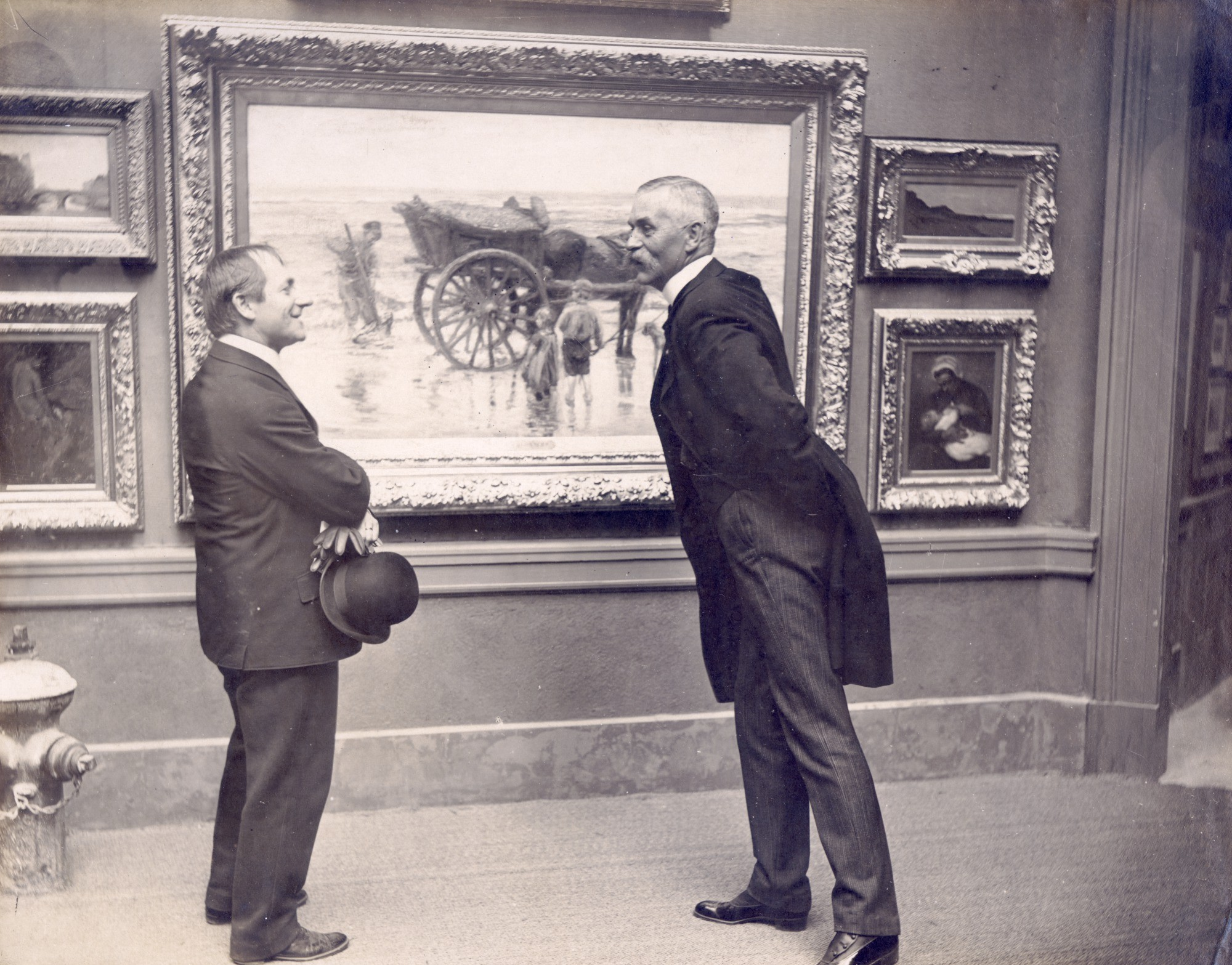 Two visitors viewing painting at the 1904 World's Fair.