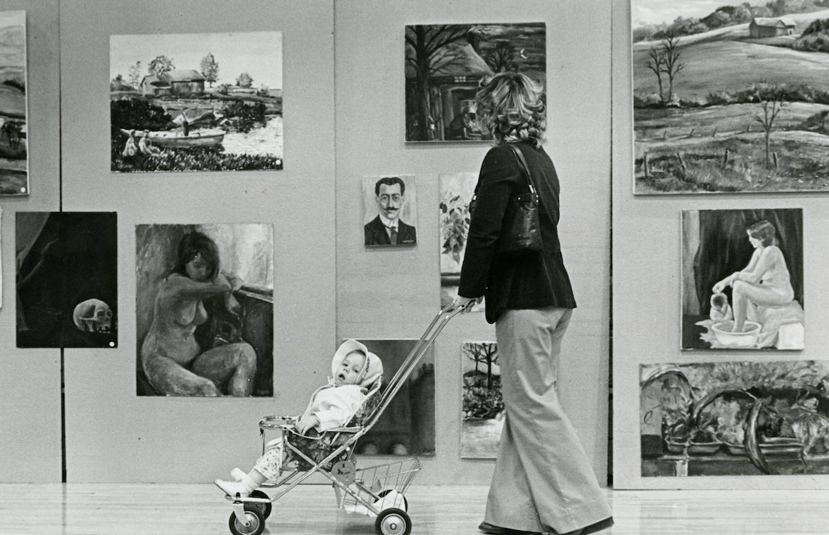 Woman viewing student artwork
